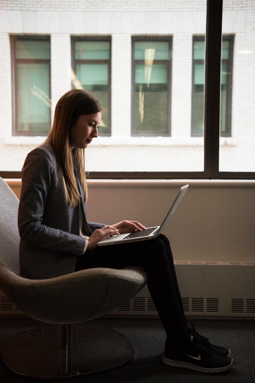 Woman remote working using laptop